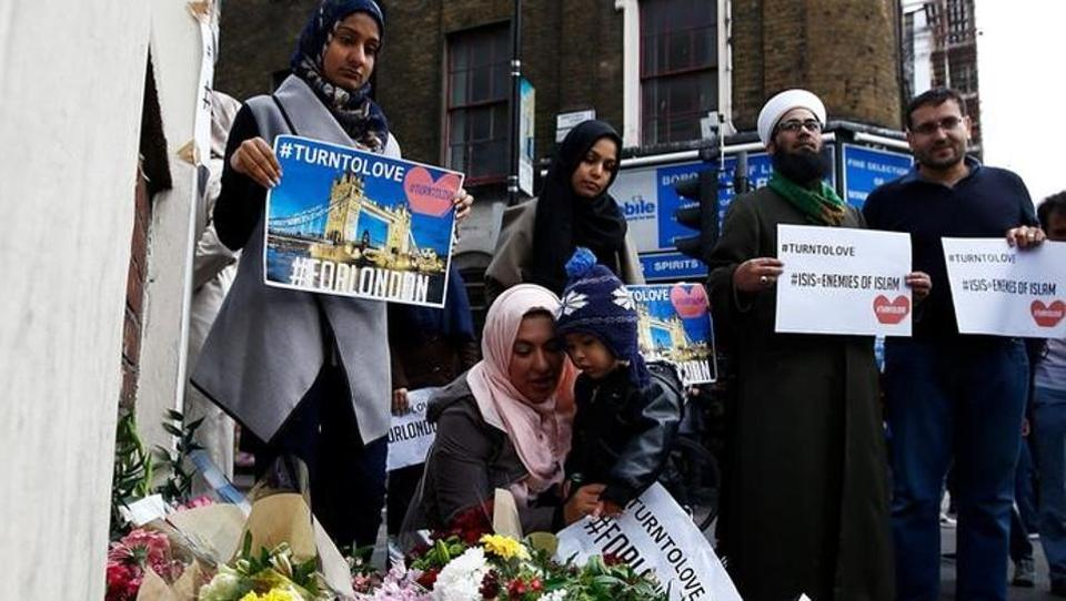 Muslims pray at a floral tribute near London Bridge, after attackers rammed a hired van into pedestrians on London Bridge and stabbed others nearby killing and injuring people, in London on June 4, 2017.