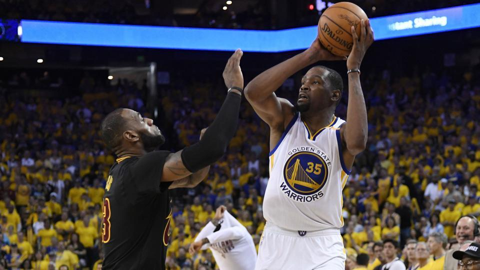 Golden State Warriors forward Kevin Durant shoots over Cleveland Cavaliers forward LeBron James during the NBA Finals.