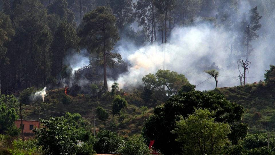 Smoke billows out after Pakistani army pounded a Rajouri area  with mortar shells.