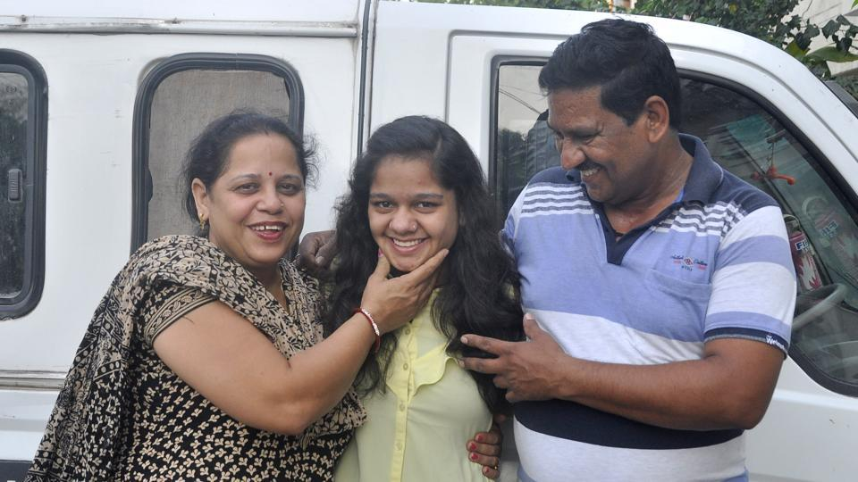 Radhika Kaushal (c) with her parents in Panchkula.