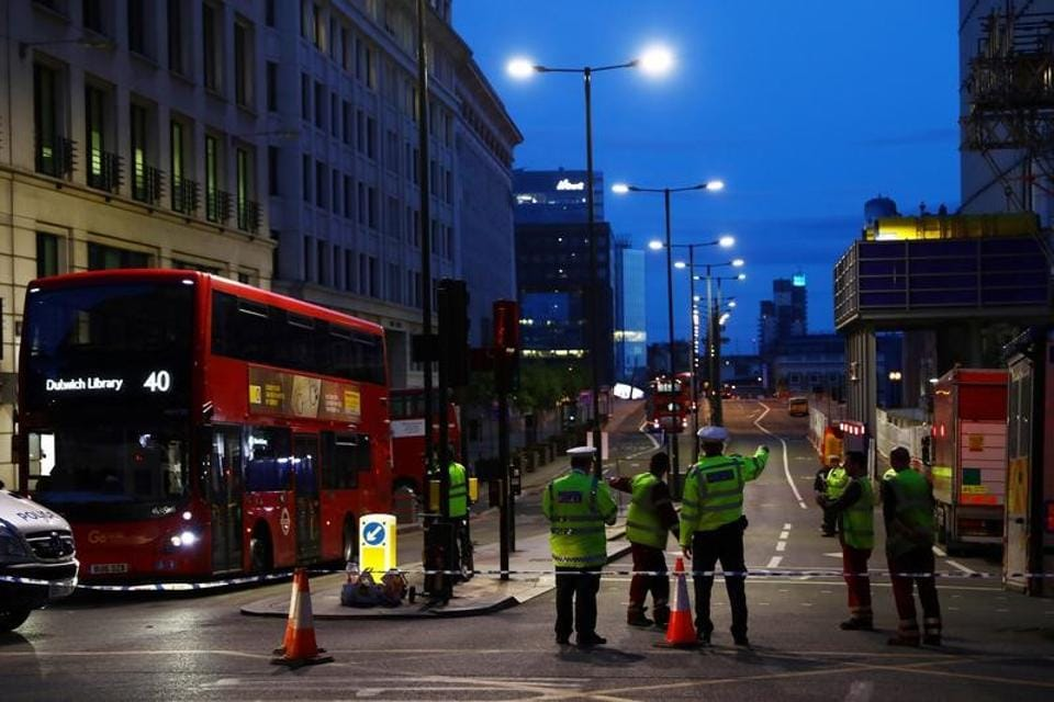 Police guard a cordon on the north side of London Bridge, after attackers rammed a hired van into pedestrians on London Bridge and stabbed others nearby killing and injuring people, in London on June 4, 2017.