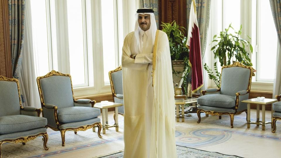 In this Aug. 3, 2015 file photo, Qatar Emir Sheik Tamim bin Hamad Al-Thani waits for the arrival of US Secretary of State John Kerry ahead of their meeting, at Diwan Palace in Doha, Qatar.