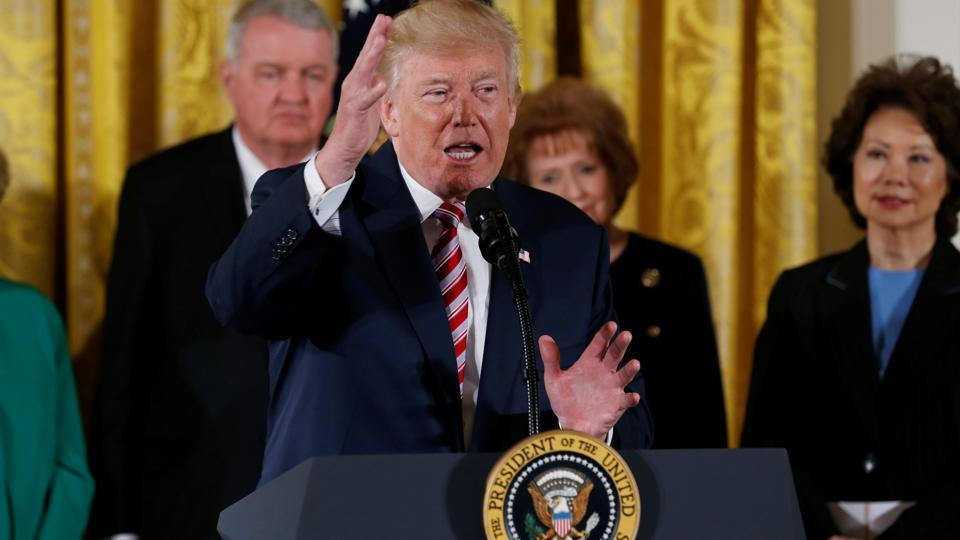 US President Donald Trump announces his initiative on air traffic control with transportation secretary Elaine Chao (right) at his side in the East Room of the White House in Washington, US, on June 5, 2017.