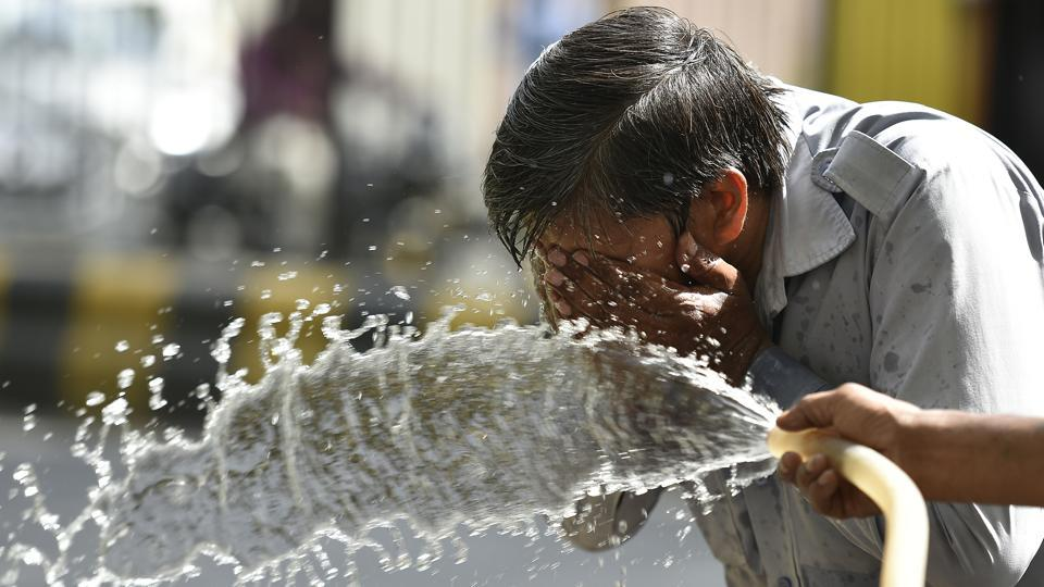 A heat haze engulfed roads and a dry hot wind threatened to sap out every ounce of body fluid on Sunday as the mercury touched 44.6 degrees Celsius, four notches above normal, in the city reeling under a heatwave.  (Raj K Raj/HT PHOTO)
