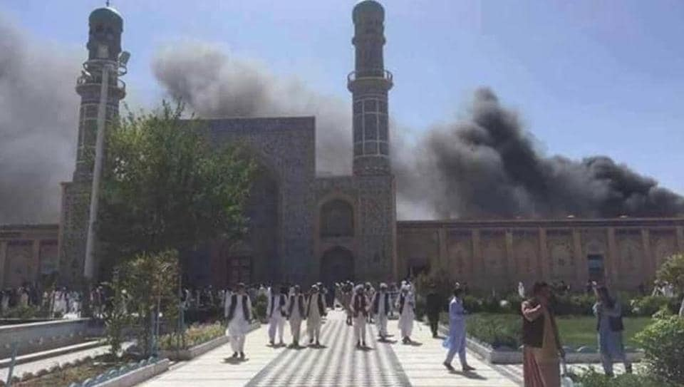 Smoke billows into the sky over the Jamay Mosque in Herat after an explosion in its parking lot killed at least seven people on June 6, 2017.