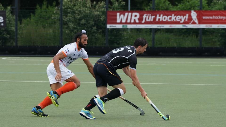 Sardar Singh (left) in action for India against Germany at the 3 Nations Invitational Tournament.
