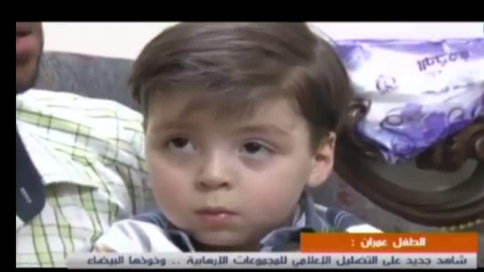 Omran Daqneesh, the Syrian boy captured in a bloodied photo, appears with his father in a video clip, apparently still living in Aleppo.