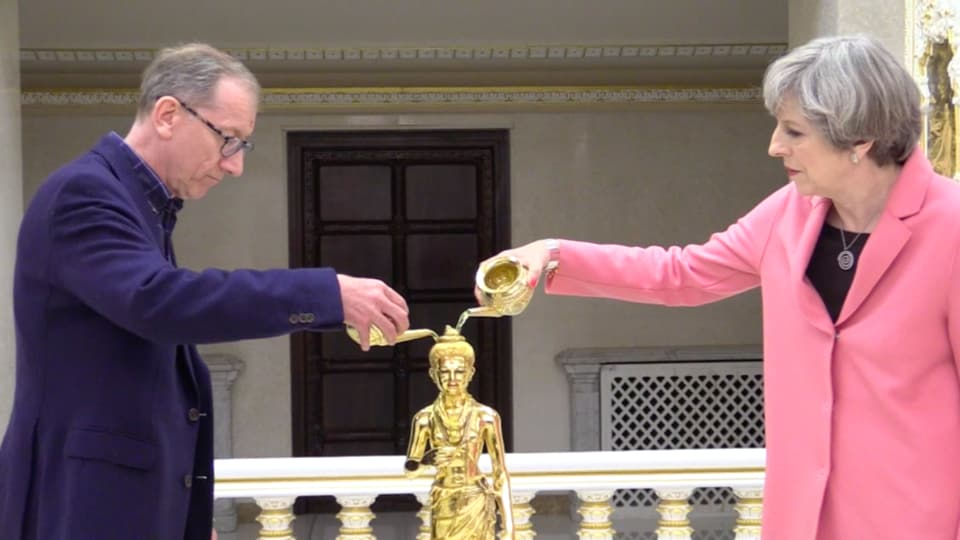 Prime Minister Theresa May and her husband Philip May performing the 'abhishek' ritual at the BAPS Shri Swaminarayan temple in northwest London.