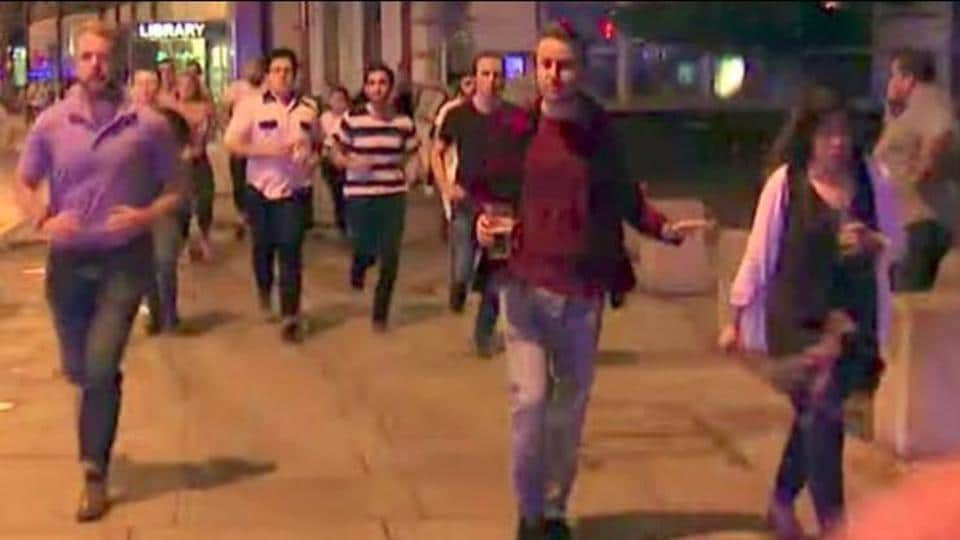 A still from the video showing the man fleeing the attacks while holding a pint of beer (R) in London on Saturday night.