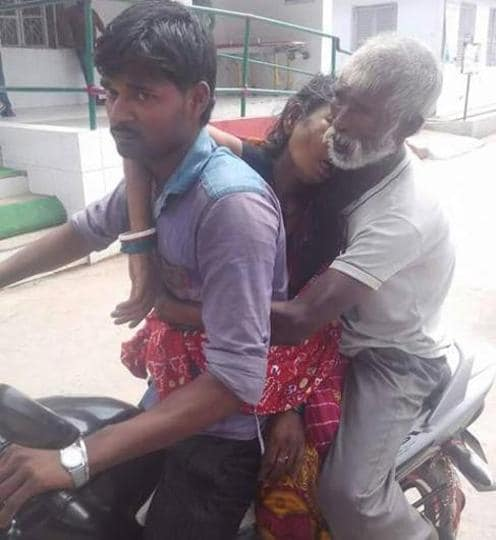 A daily wager carries the body of his wife on a motorbike, driven by his son in Purnia.