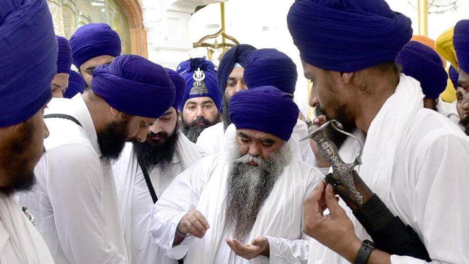 Damdami Taksal chief Harnam Singh Dhumma along with others at Akal Takht Sahib.  (Gurpreet Singh/HT Photo)