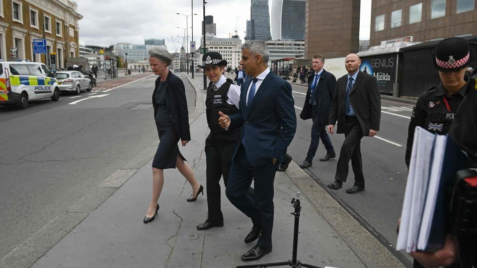 "Metropolitan Police commissioner Cressida Dick (second from left) and London mayor Sadiq Khan (centre) are shown across the south side of London Bridge on June 5, 2017 to see the site of the terror attack. Khan has called on the UK government to cancel the proposed visit of US President Donald Trump, saying he was wrong on ""many things""."