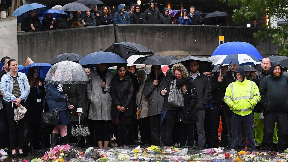 People observe a minutes' silence at south-side of London Bridge in London on June 6 in memory of the victims of the terror attacks. Italy's main newspapers named the suspect as Youssef Zaghba even though British police didn't name the third attacker.