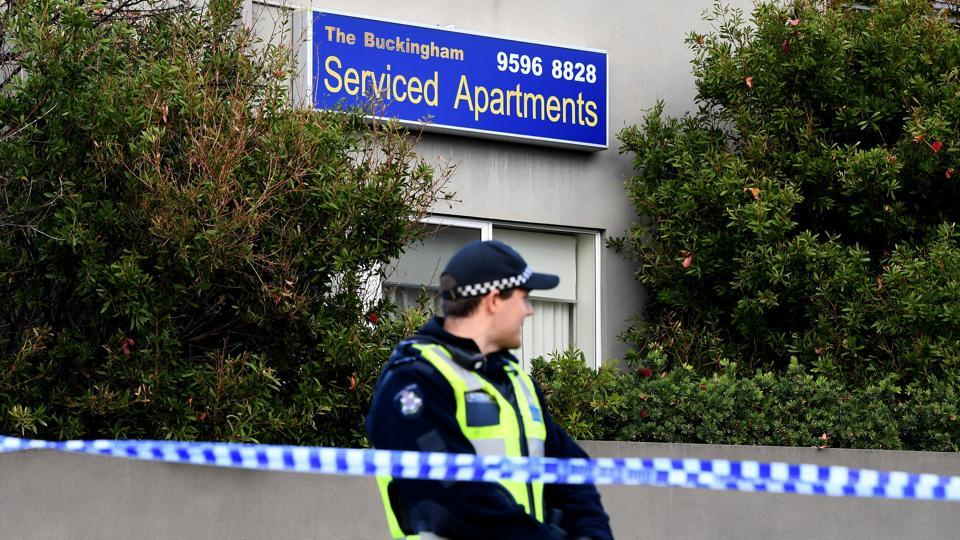 A police officer stands guard outside the Buckingham Serviced Apartments in Brighton in Melbourne, Australia, June 6, 2017, where a hostage incident took place on Monday.