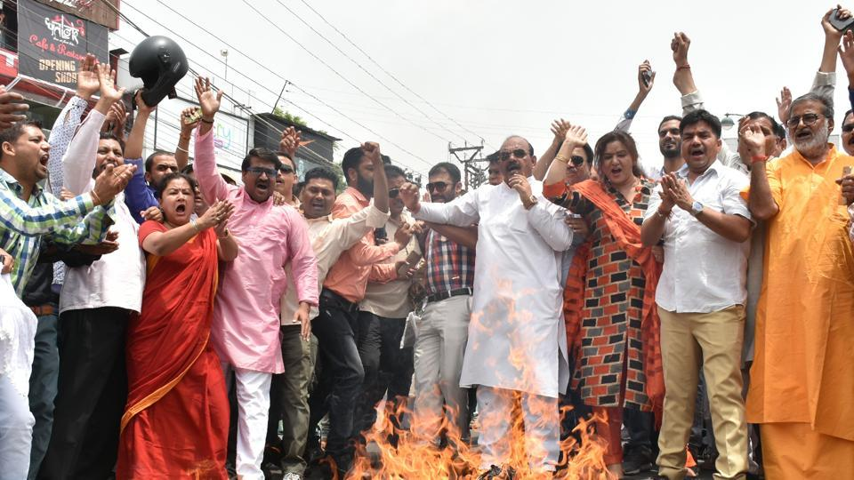Congress workers protesting against the Uttarakhand government's 'anti-people decisions'  in Dehradun on Tuesday.