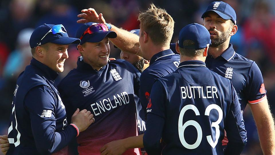 England's Joe Root (2nd L) celebrates with teammates after catching New Zealand's Ross Taylor in their ICC Champions Trophy clash. Get highlights of England vs New Zealand here.