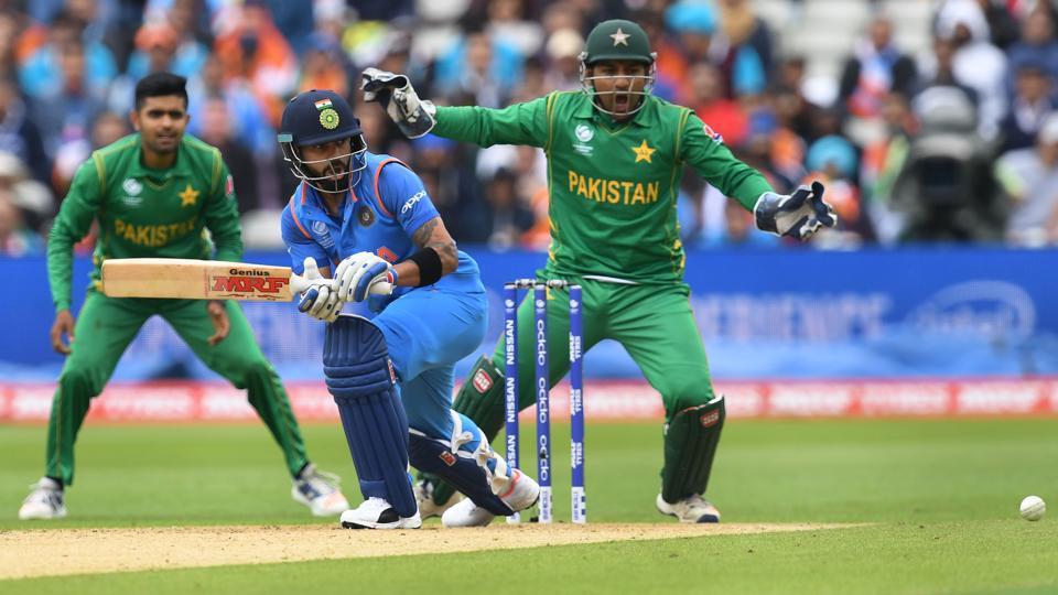 Indian cricket team captain Virat Kohli bats as Pakistan wicket-keeper Sarfraz Ahmed looks on during the ICC Champions Trophy at Edgbaston in Birmingham on June 4, 2017.