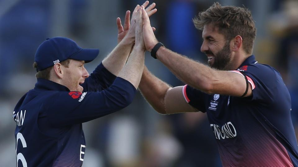 England's Liam Plunkett and Eoin Morgan celebrate at the end of the match. (REUTERS)