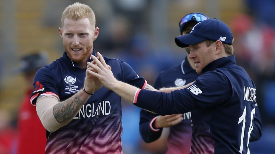 England's Ben Stokes celebrates the wicket of New Zealand's Martin Guptill with Eoin Morgan. (REUTERS)