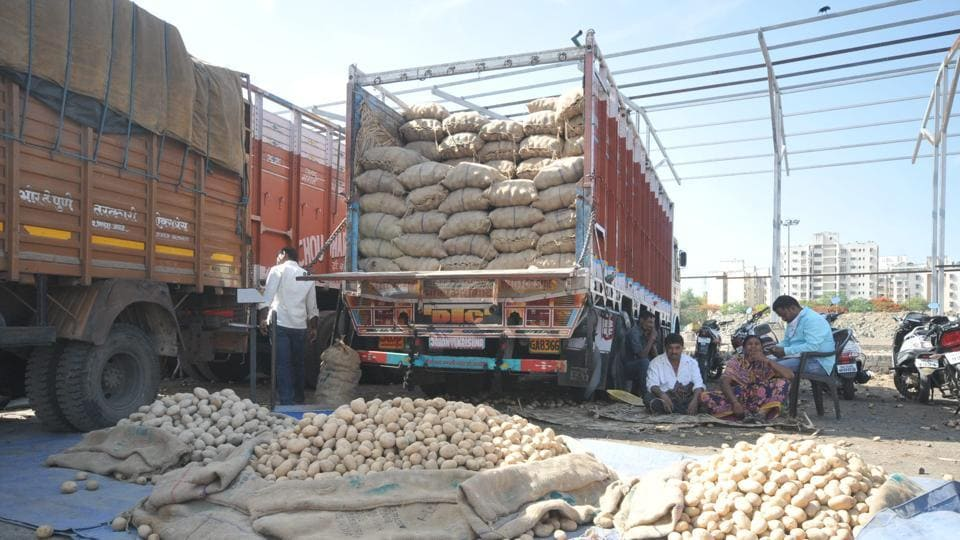 Trucks carrying vegetables and fruits arrive at the Pune market on Tuesday.