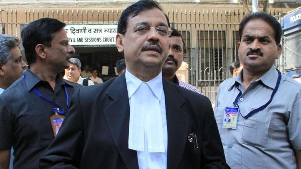 Ujjwal Nikam interacts with media outside the sessions court in Mumbai.
