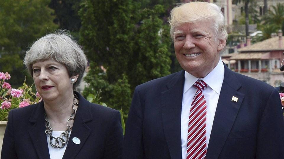 British Prime Minister Theresa May and US President Donald Trump during the G7 Summit  in Taormina, Italy on May 26, 2017.