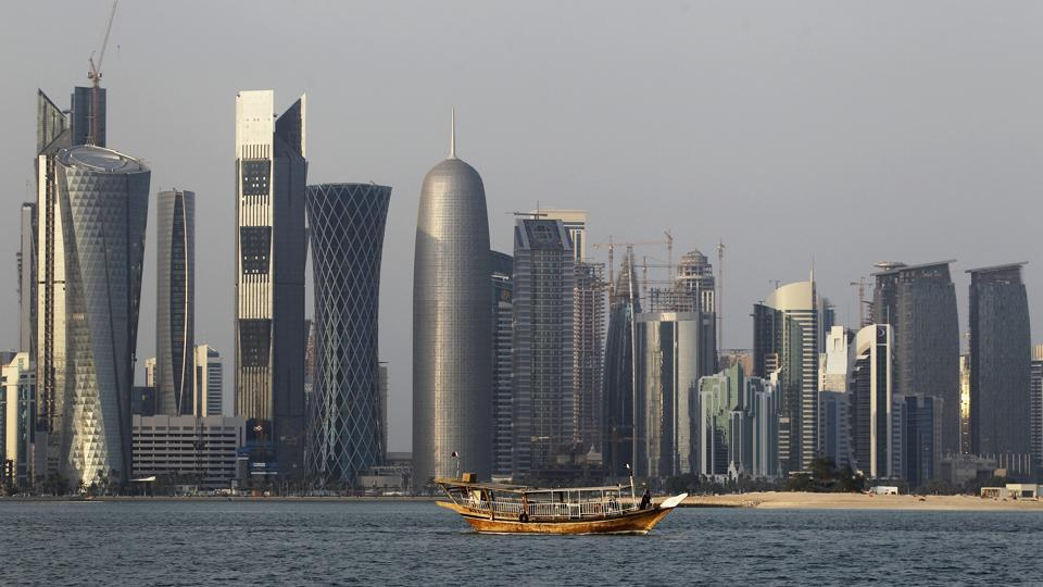 In this Jan. 6, 2011 file photo, a traditional dhow floats in the Corniche Bay of Doha, Qatar, with tall buildings of the financial district in the background.