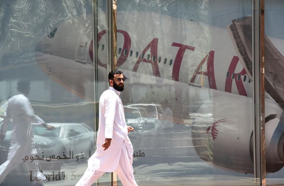 A man walks past the Qatar Airways branch in the Saudi capital Riyadh, after it had suspended all flights to Saudi Arabia following a severing of relations between major Gulf states and Qatar.