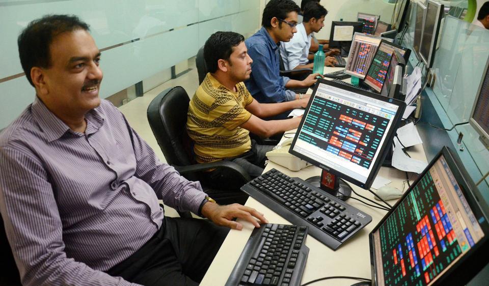 A broker reacts in Kolkata as Sensex and Nifty surge on Tuesday.