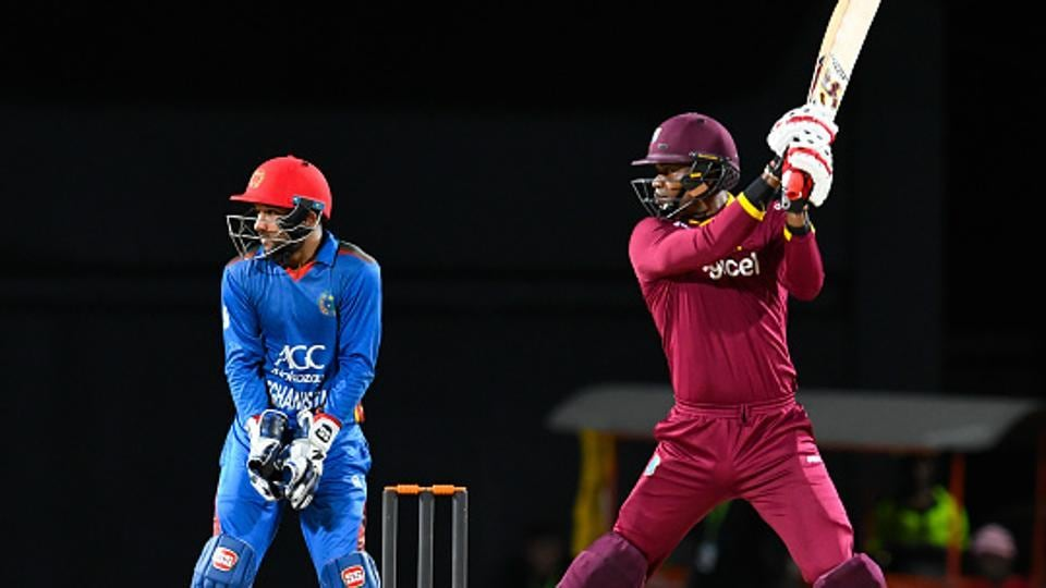 Marlon Samuels (R) of the West Indies cricket team (Windies) hits a boundary as Shafiqullah Shafaq (L) looks on during the 3rd and final T20 International match against Afghanistan national cricket team at Warner Park, Basseterre, St. Kitts and Nevis, on Monday.