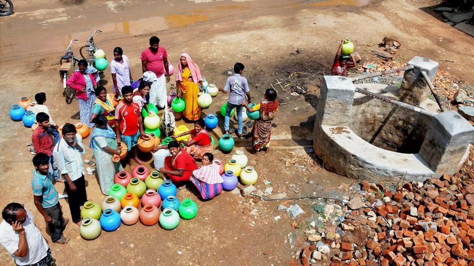 People gather around a well in a drought-hit area in Lakya near Chikmagalur, Karnataka on June 5.