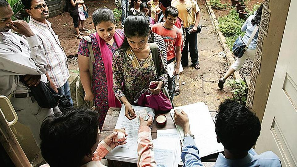 Students queue up to collect their admissions forms outside Podar College in Matunga