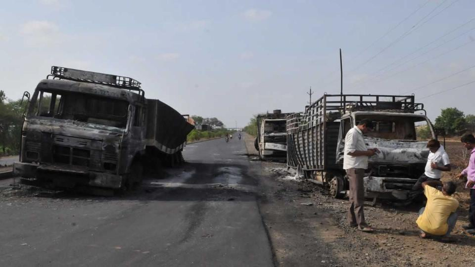 Burnt vehicles on the Mhow-Neemuch highway on Wednesday.