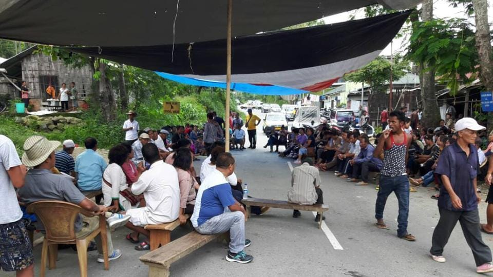 People camp at the National Highway 54, regarded as the lifeline for Mizoram.