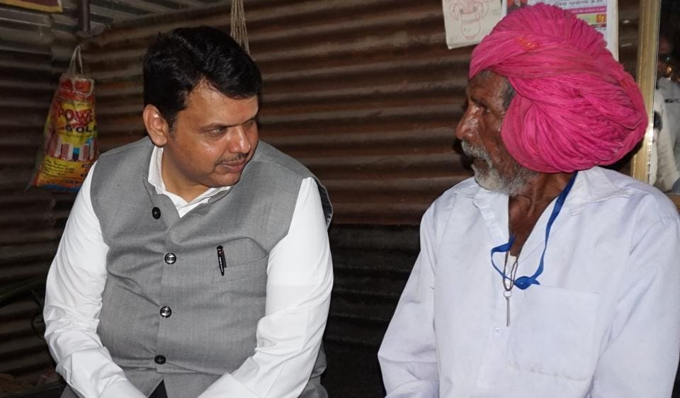 Chief minister Devendra Fadnavis interacts with a farmer in Latur during Shivar Samwad, organised by the BJP, in May.