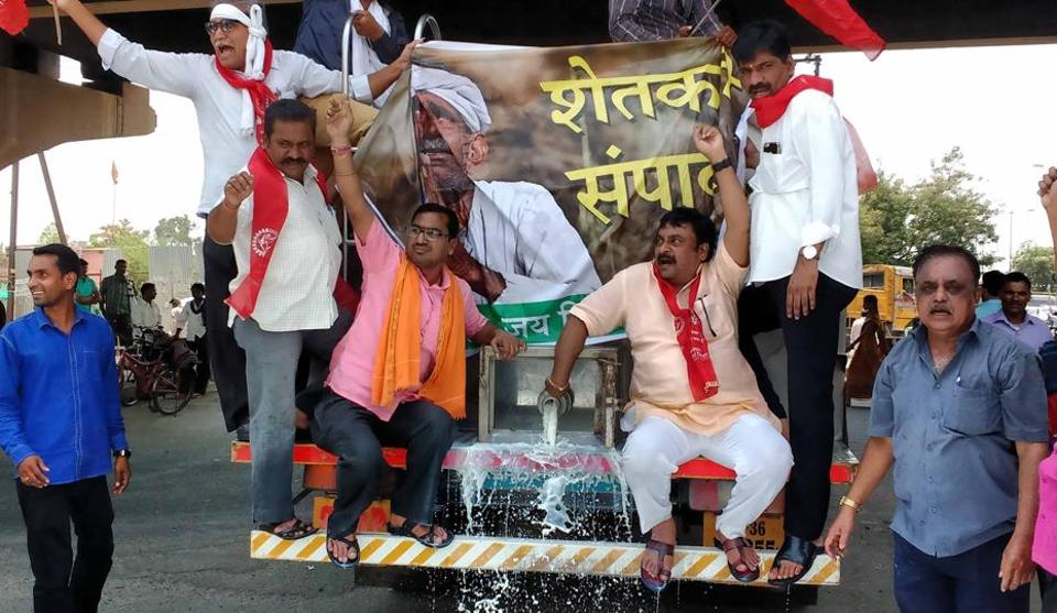 Farmers spill milk on Nagpur roads on Monday to demand a loan waiver for all the farmers in state.