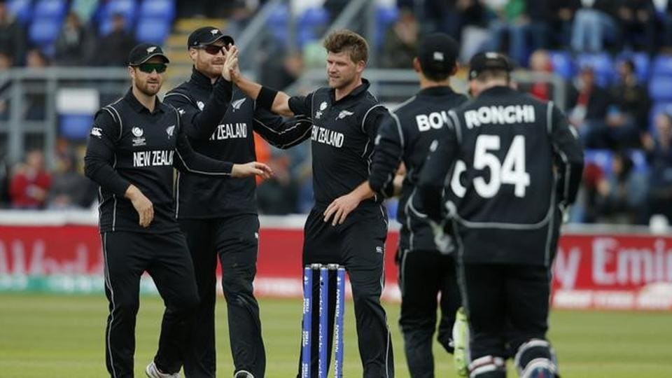 New Zealand cricket team's Corey Anderson celebrates with teammates the wicket of England cricket team's Moeen Ali during their ICC Champions Trophy 2017 match in Cardiff on Tuesday.