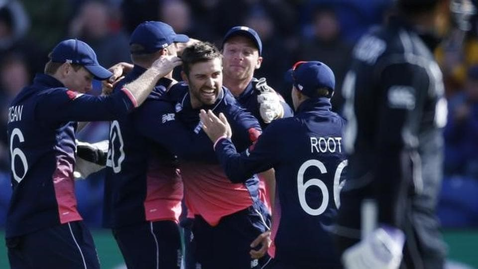 England cricket team's Mark Wood celebrates with Joe Root and teammates after taking the wicket of New Zealand national cricket team skipper Kane Williamson during their ICC Champions Trophy 2017 match in Cardiff, Wales, on Tuesday.