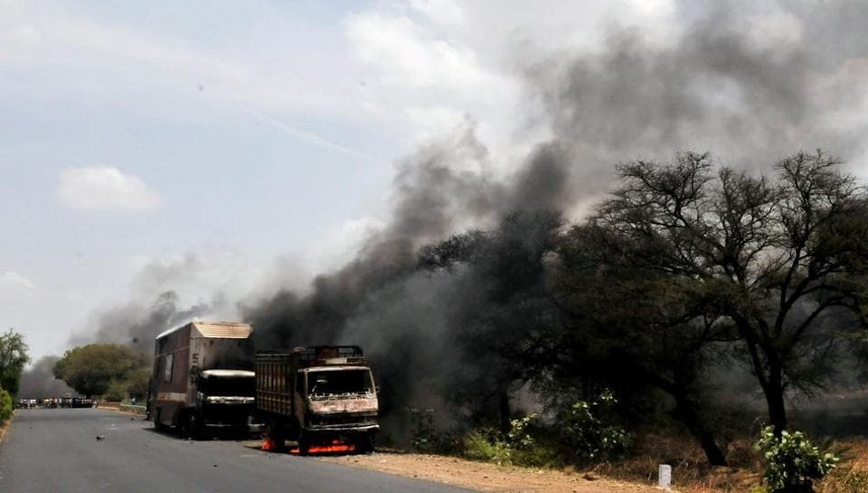 Farmers torch trucks in Madhya Pradesh's Mandsaur district during protests on Wednesday.