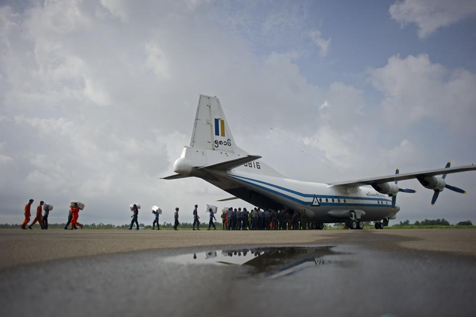 This file photo taken on August 5, 2015 shows a Myanmar Air Force Shaanxi Y-8 transport aircraft being unloaded at Sittwe airport in Rakhine state, similar to the aircraft carrying over 100 people that went missing between the southern city of Myeik and Yangon on June 7, 2017.