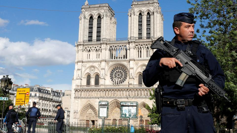 French police and gendarmes stand at the scene of a shooting incident near the Notre Dame Cathedral in Paris, France, June 6, 2017.