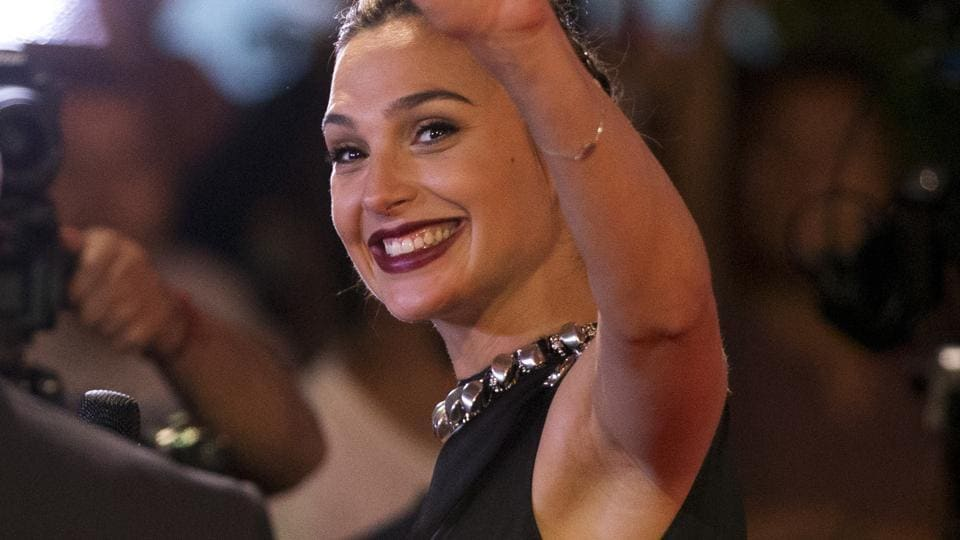 Actor Gal Gadot waves to cheering fans as she does interviews with journalists at the Latin American premiere of the film Wonder Woman, in Mexico City.