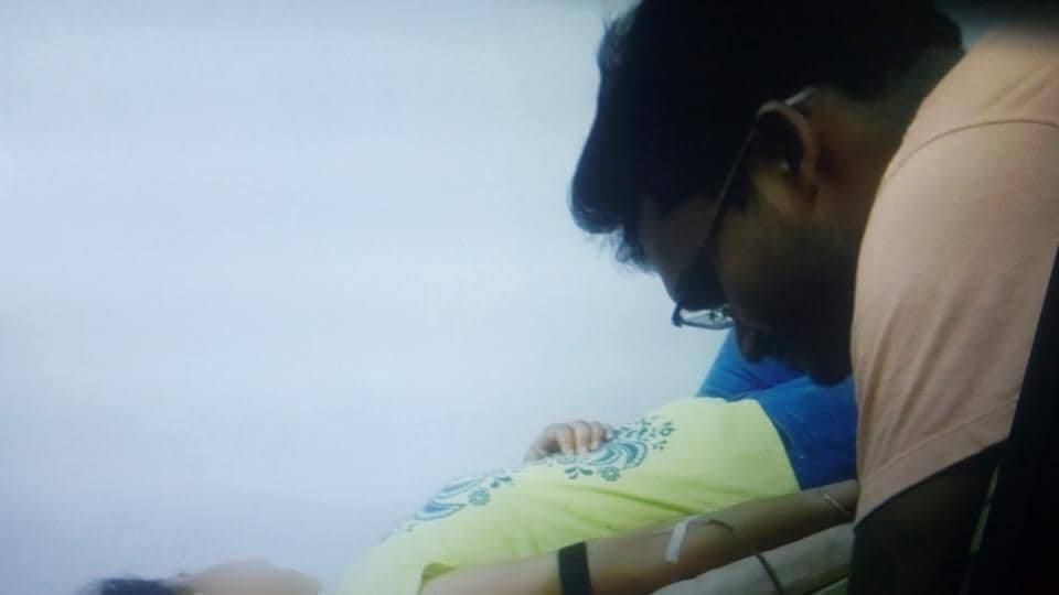 Stills of video footage in which a blood bank staff is seen collecting blood from a girl at a private hospital violating the blood transfusion law at Kanke in Ranchi