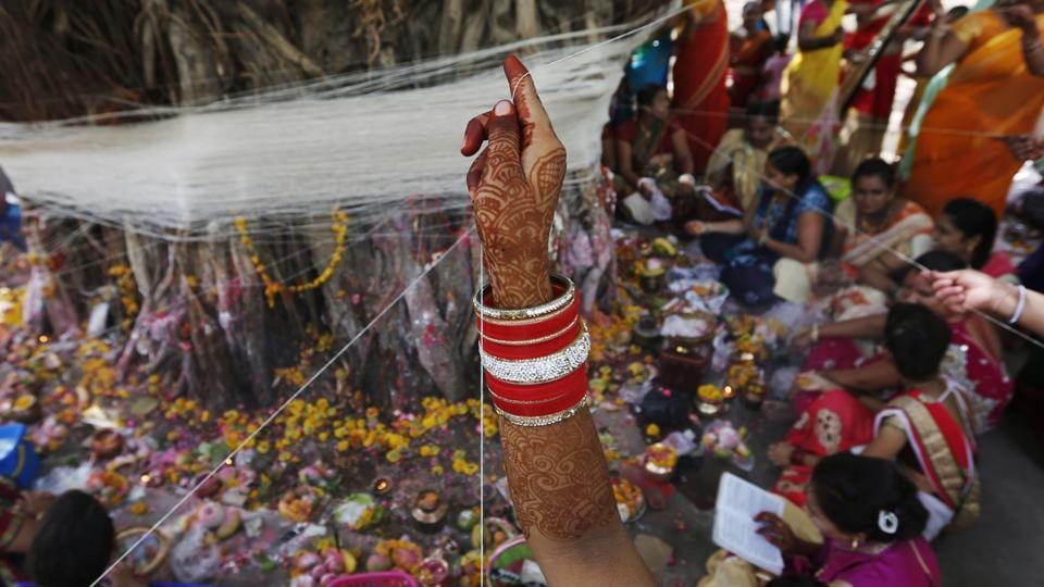 Thousands of married women observe `Vat Savitri' puja at various parts of the country. Vat Savitri Vrat Puja or Savitri Brata also known as Savitri Amavasya is an important Hindu festival celebrated by the married women for the long life of their husbands.  (Ajit Solanki / AP)