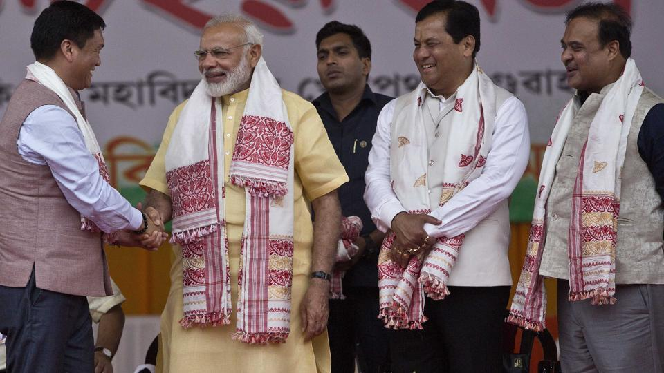 Prime Minister Narendra Modi,  shakes hands with Chief Minister of Arunachal Pradesh Pema Khandu, as Assam Chief Minister Sarbananda Sonowal, and Health Minister Himanta Biswa Sarma, right, stand beside them during an event in Guwahati, Assam, on May 26, 2017.