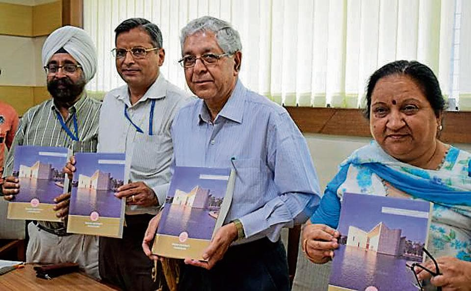 (From left) Controller of examination Parvinder Singh, former dean instructions Dinesh Kumar, PU V-C Arun Grover and dean university instructions Minakshi Malhotra releasing a handbook of information at the PU on Wednesday.