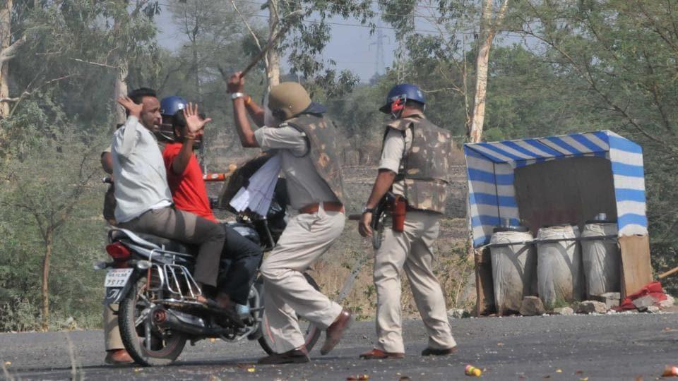 Police cane commuters on the Mhow- Neemuch highway in Mandsaur, Madhya Pradesh, on Wednesday.