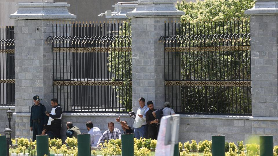 Iranian forces and civilians take cover during as gunmen attack the parliament building in central Tehran.  (REUTERS)