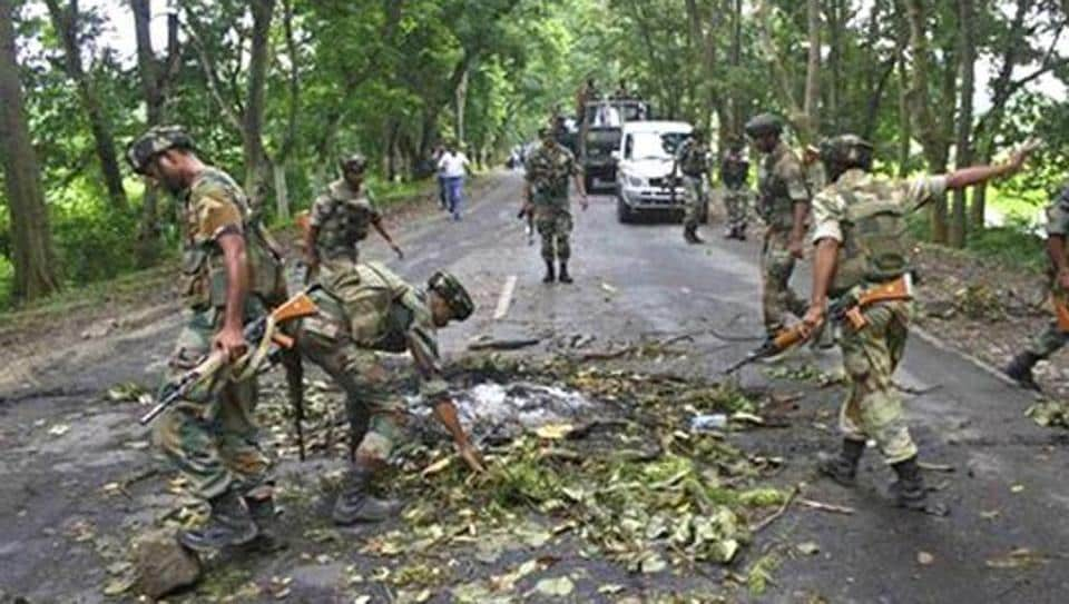 Army personnel clear the site of an encounter.