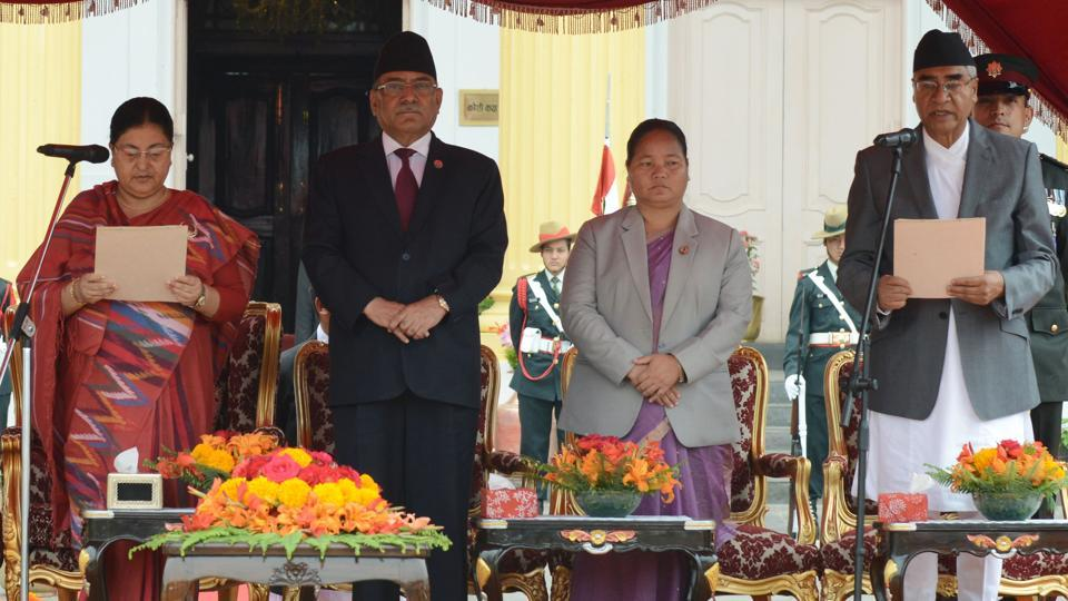 "Nepal's newly elected Prime Minister Sher Bahadur Deuba (right) is sworn in by President Bidhya Bhandari (left), as outgoing prime minister Pushpa Kamal Dahal ""Prachanda"" (2nd from left) looks on at the President's House in Kathmandu on June 7, 2017. Nepal's parliament on June 6 elected the three-time former prime minister to the top post again, the tenth time in just over a decade the leadership has changed hands in the Himalayan nation."